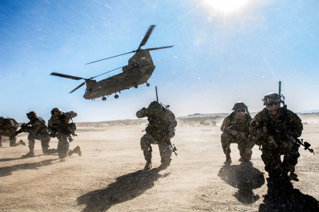 Soldiers maintain security as a CH-47 Chinook departs the HLZ during an air assault training exercise in the National Training Center, Calif., Jan. 25, 2017. The purpose of this mission was to demonstrate the troop's ability to carry out complex attacks while enhancing the unit's ability of employing aviation resources.