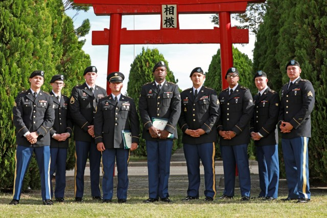 SAGAMIHARA, Japan - Nine Soldiers and noncommissioned officers assigned to various units throughout 38th Air Defense Artillery Brigade gather during the Pacific Guardian of the Quarter Competition closing ceremony at Sagami General Depot Nov. 7. Staff Sgt. Alfred Taitano (center left), Patriot fire control enhanced operator/maintainer, and Spc. Isaac Swilling (center right), petroleum supply specialist, both with Echo Battery, 3rd Air Defense Artillery Regiment, Terminal High Altitude Area Defense (THAAD), won the NCO and Soldier categories respectively during the grueling test of their physical and mental abilities Nov. 6-7.