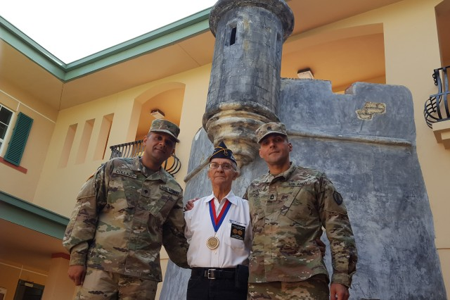 Victor Labarca, President of the 65th Infantry Regiment Association (Borinqueneers), and Korean War Veteran, (center) met with Sgt. 1st Class Cesar Méndez, a Mortuary Affairs Noncommissioned Officer, who deployed 72 hours after the September 11, 2001 attacks, with the 311th Quartermaster Company(right), and Spc. Anthony Collazo, a Personnel Administration Specialist who recently returned from Korea, after successfully completing a mission with the 271st Human Resources Company (left), Nov 11, at the U.S. Army Reserve-Puerto Rico headquarters.