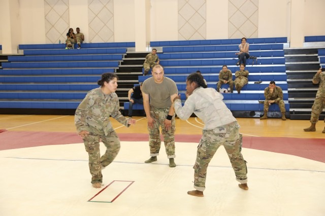 Tournament's Two Females Square-off during the Red Dragon Royal Rumble Combatives Tournament