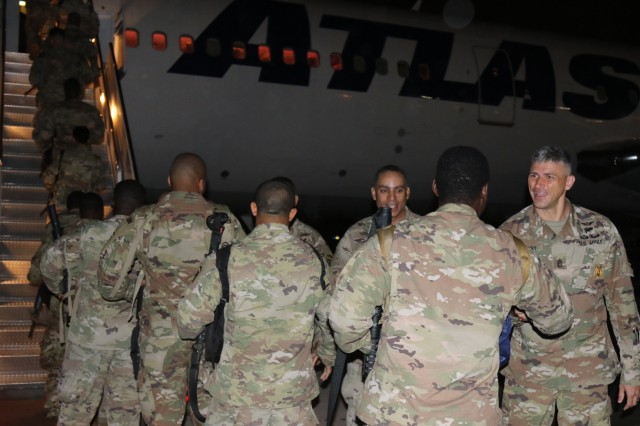 U.S. Army Soldiers from 1st- 82nd Attack Reconnaissance Battalion, 82nd Combat Aviation Brigade, 82nd Airborne Division, Fort Bragg, prepares to board a flight to the United States Central Command Area of Operations (CENTCOM). Grey Eagles deploy to support CENTCOM operating environment which umbrellas Operations Inherent Resolve and U.S. Military Training Missions committed to work with and through regional partners to increase regional stability. (Photo by Army Staff Sgt. Sharon Matthias)