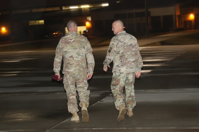 U.S. Army Maj. Gen. James Mingus,(right), commanding general of the 82nd Airborne Division speaks with U.S. Army Col. Ernest Irvin, commander of the 82nd Combat Aviation Brigade,  after supporting Soldiers from 1st- 82nd Attack Reconnaissance Battalion, 82nd Combat Aviation Brigade, 82nd Airborne Division, Fort Bragg, before they boarded a flight to the United States Central Command Area of Operations (CENTCOM). Grey Eagles deploy to support CENTCOM operating environment which umbrellas Operations Inherent Resolve and U.S. Military Training Missions committed to work with and through regional partners to increase regional stability. (Photo by Army Staff Sgt. Sharon Matthias)