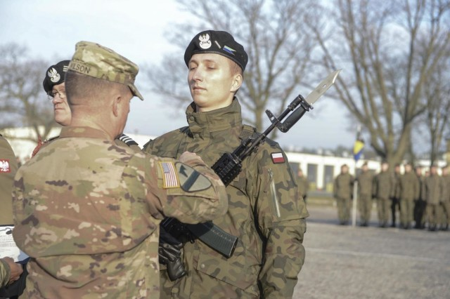 Col. Jeremy Wilson, commander of the 2nd Armored Brigade Combat Team, 1st Cavalry Division, and Command Sgt. Maj. Alexander Yazzi, command sergeant major of the 2 ABCT, 1st Cav. Div., presented four Polish Soldiers with the Army Achievement Medal on behalf of the U.S. Army during the 34th Armored Cavalry Brigade, 11th Armored Cavalry Division's Polish Independence Day Ceremony in Zagan, Poland, Nov. 8, 2019. (U.S. Army Photo by Staff Sgt. Noshoba Davis)
