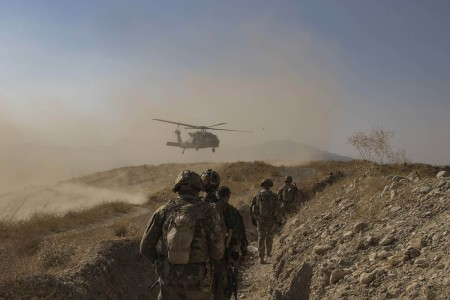 Afghan National Army soldiers with U.S. and Coalition advisors assigned to the 1st Armored Division, prepare to conduct an extraction from a forward outpost during an Afghan-led and executed clearance operation, Sept. 25, 2019, in Southeastern Afghan...