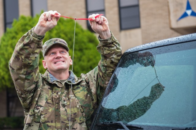The Commanding General of the 13th Expeditionary Sustainment Command's, Brig. Gen. Darren L. Werner, ties a red ribbon on his jeep antenna Nov. 7.  As part of the Tie One On for Safety Campaign pledge, the red ribbon symbolizes the blood of the victims who lost their lives during alcohol related traffic incidents, and exemplifies the 13th ESC's and Ft. Hood's commitment to preventing drinking and driving occurrences.