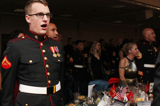 """Lance Cpl. Jeffrey Letour, Fort Sill MARDET logistician, sings the """"Marines' Hymn"""" along with other Marines and family members Nov. 9, 2019, at the birthday celebration. """"I want to keep in mind for the rest of my life how much Marines have done, and what we will do for the world,"""" Letour said."""