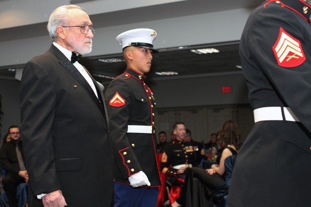 The cake detail exits the ballroom Nov. 9, 2019, at the Patriot Club. The oldest Marine in attendance was Sgt. James Lasswell (with beard), age 74; and the youngest Marine was Lance Cpl. Chontu Lee (next to Lasswell), 20.