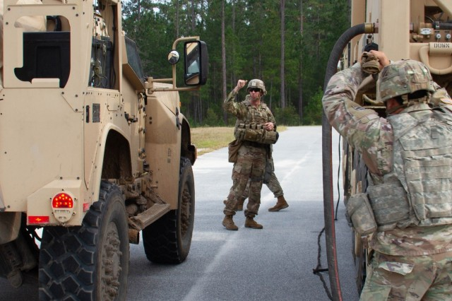 The commander of 1st Battalion, 41st Field Artillery Regiment, 3rd Infantry Division Artillery, Lt. Col. Jeff Fuller, ground-guides and refuels his joint light tactical vehicle during a training exercise Nov. 6, 2019 at Fort Stewart, Ga. Fuller, a native of Coshocton, Ohio, participated in the exercise, named Marne Focus, to test brigade-level headquarter battle systems in preparation to ready the 1st Armored Brigade Combat Team for a U.S. Army Combat Training Center rotation at the National Training Center at Fort Irwin, Calif. (U.S. Army photo by Sgt. 1st Class Jeff Smith)