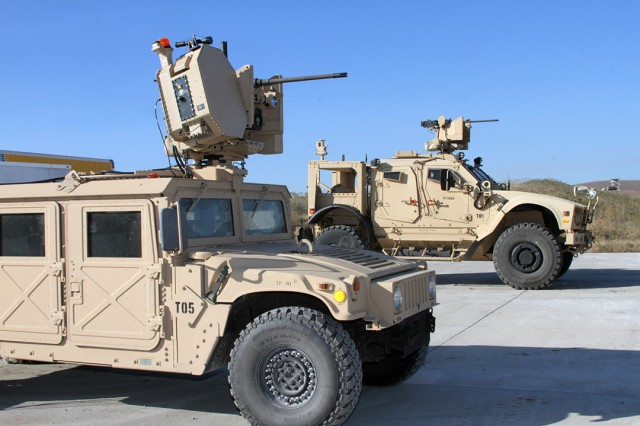 Remotely operated weapon systems are featured on a Humvee (foreground) and an MRAP (Mine Resistant Ambush Protected) All Terrain Vehicle (M-ATV) Nov. 4, 2019, at Fort Sill's Thompson Hill Range Complex. The weapons systems were being experimented on to detect, identify, and destroy drones during the Maneuver and Fires Integration Experiment 20.