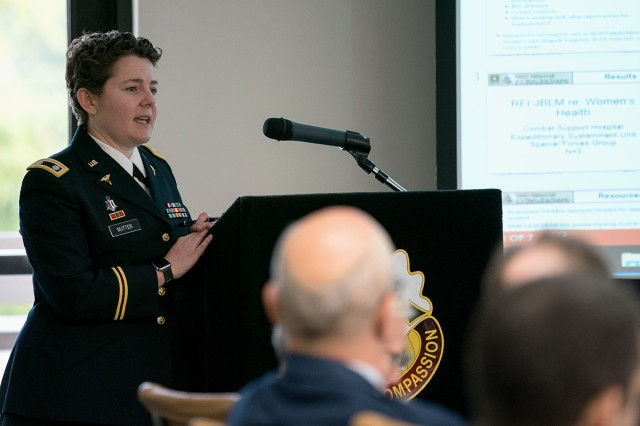 Lt. Col. Elizabeth Nutter, the chief of Obstetrics/Gynecology Ambulatory Services and Midwifery Services, answers a question regarding active duty women's healthcare on base, to the Defense Health Board as they visit Madigan Army Medical Center on Joint Base Lewis-McChord, Wash., on Nov. 4.