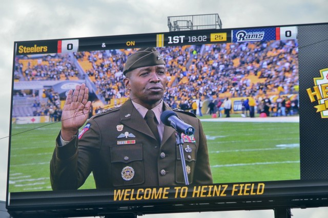 Lt. Gen. Bruce Crawford, the Army's chief information officer, administers the oath of enlistment with more than 60 future Soldiers, Sailors and Airmen during a mass joint-service swear-in ceremony at Heinz Field before the Pittsburgh Steelers vs. Los Angeles Rams football game. The pre-game ceremonies were conducted Nov. 10, 2019, in recognition of Veterans Day.