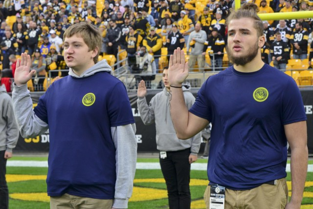Future Sailors from Navy Talent Acquisition, NTAG Pittsburgh, recite the oath of enlistment during a mass joint-service swear in ceremony at Heinz Field.  Lt. Gen. Bruce Crawford, the Army's chief information officer, administered the oath for more than 60 future Soldiers, Sailors and Airmen enlisted during pre-game ceremonies, at the Pittsburgh Steelers vs. Los Angeles Rams football game, Nov. 10, 2019, conducted in recognition of Veterans Day.