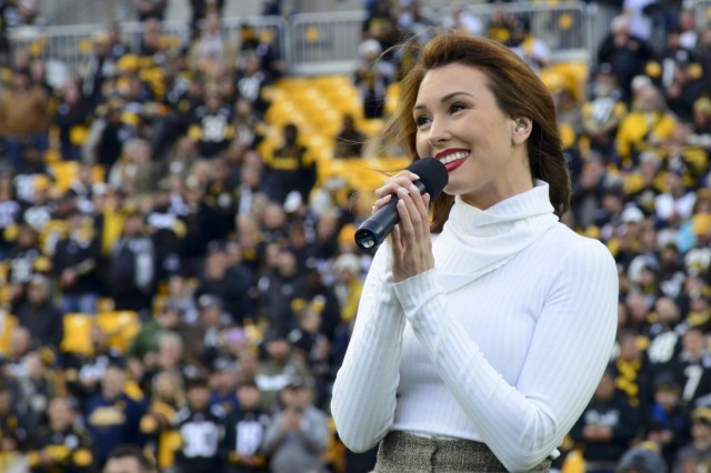 """Singer and songwriter Loren Allred, a Pittsburgh native, performs her hit single """"Never Enough"""" during a mass joint-service enlistment ceremony at Heinz Field. More than 60 future Soldiers, Sailors and Airmen took the oath of enlistment in the pre-game ceremonies of the Pittsburgh Steelers vs. Los Angeles Rams football game, Nov. 10, 2019. The pre-game ceremonies were conducted in recognition of Veterans Day."""