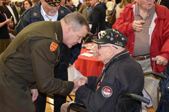 Lt. Gen. James H. Dickinson, commanding general, U.S. Army Space and Missile Defense Command, thanks World War II veteran Sherwin Callander for his service during the 14th annual Veterans Prayer Breakfast at the Hogan YMCA in Madison, Alabama, Nov 8. (U.S. Army photo by Jason B. Cutshaw)