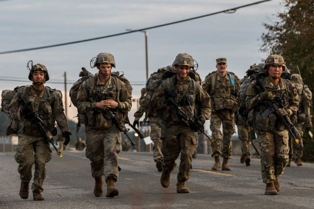 """A squad of Soldiers stick together during a 12-mile road march for 2nd Stryker Brigade Combat Team, 2nd Infantry Division's  Expert Infantry Badge and Expert Soldier Badge testing at Joint Base Lewis-McChord, Oct. 31, 2019. """"I think it's nice with the integrated squads,"""" said Sgt. 1st Class James Craig Gwillim II, the non-commissioned officer in charge of the tactical operations center at the testing site. """"It allows them to share the experience with each other, so it helps build the team. Everyone's going through the same thing."""""""