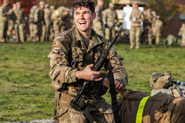 "Pfc. Aidan Polonsky, an infantryman with 2nd Battalion, 75th Ranger Regiment, flashes a smile of relief after successfully completing the last event of 2nd Stryker Brigade Combat Team, 2nd Infantry Division's  Expert Infantry Badge testing at Joint Base Lewis-McChord, Oct. 31, 2019. ""Weeks of training, pt tests, day and night land nav, 30 tasks and a 12-mile road march, and you're standing here this morning a success,"" said Brig. Gen. Timothy Leahy, deputy commanding officer for operations, 7th Infantry Division. ""You've done your part to make yourselves and our Army better - more ready and more lethal."""