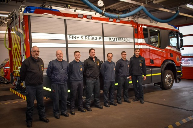 Left, Katterbach Army Airfield firefighters Roland Haering, Armin Brinschwitz, Daniel Schlensog, Jonas Grossmueller, Daniel Soldner, David Ernst and Fire Chief Stefan Groetschel, responded to an explosion inside a residential home in Ansbach, Germany Nov. 7. The firefighters are standing in front of one of the new rescue pumpers used in the incident.