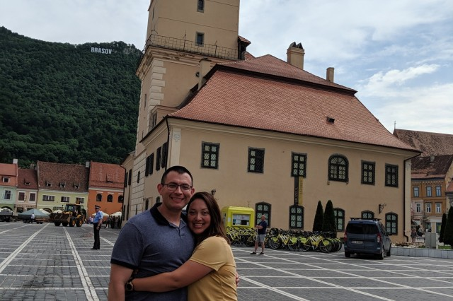 Sgt. Kenny Quintana and Sgt. Leslie Hernandez pose for a picture in the Brasov, Romania, town square while on a morale trip on June 24, 2019. Quintana and Hernandez traveled to Romania with the 211th Regional Support Group to participate in Operations Saber Guardian.