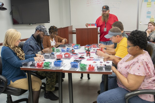 Students in Anniston Army Depot's Lean Facilitator Certification Training class learn some of the concepts of process improvement by looking at parts issues during an exercise.