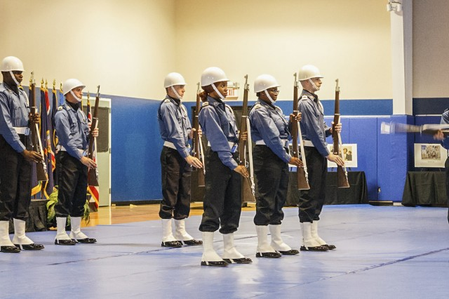The White Knights Drill Team from Marion Military Institute perform during Anniston Army Depot's Veterans Day Ceremony Nov. 7 at the Physical Fitness Center.