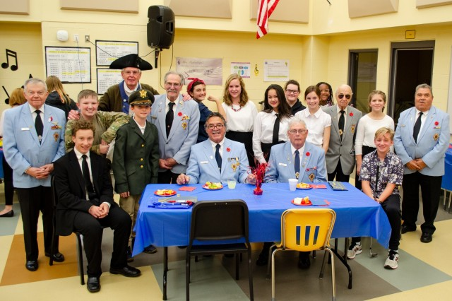 West Point Middle Schoolers in the seventh and eighth grade drama and choir class stand next to members of the Catholic War Veterans organization from New Windsor after their Veterans Day assembly Nov. 7. Photo by Kerri Schools/WPMS