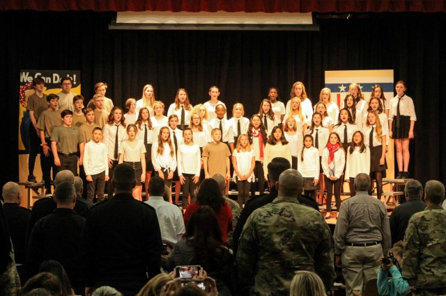 "West Point Middle School students sing the ""Service Song Medley"" while veterans and servicemembers stand at attention during their branch song. Photo by Michelle Schneider/PV"