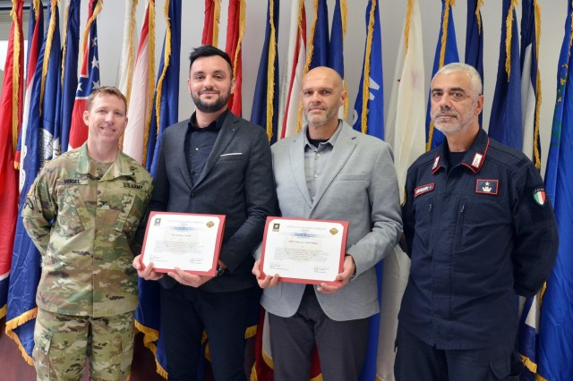 Two SETAF Carabinieri officers received letters of appreciation from USAG Italy Garrison Commander Daniel J. Vogel on Nov. 13, for coming to the aid of a Soldier injured in an Oct. 5 robbery and their subsequent investigative work that led to the arrest of the criminals who assaulted him. Left:  USAG Italy Garrison Commander Col. Daniel J. Vogel.  Right: SETAF Carabinieri Commander Italian Maj. Francesco Provvidenza. Officers in the center are not used at the request of the Carabinieri
