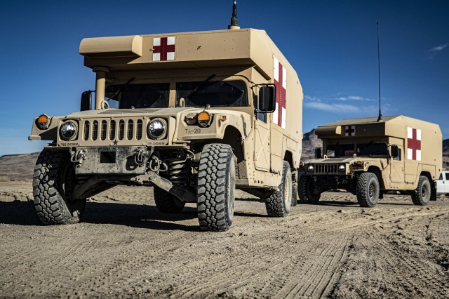 Field Litter Ambulances arrive with simulated patients during a mass casualty scenario at the field hospital at Sierra Army Depot, California, during the United States Forces Command Medical Emergency Deployment Readiness Exercise, Oct. 28, 2019. The realistic event gave Soldiers a chance to test their skills and knowledge in the event of a real mass casualty incident.