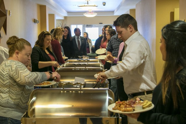 Veterans and their family members serve themselves breakfast at the AUSA Veterans Day breakfast at the Hilton Garden Inn, Nov. 12, Watertown N.Y. (U.S. Army photo by Sgt. Phillip Tross)