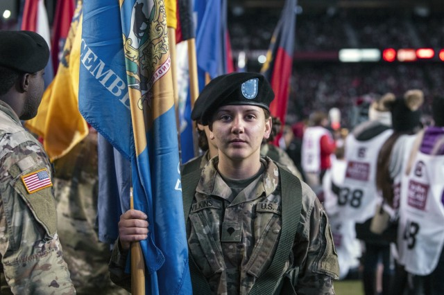 Soldiers from 1st Battalion, 34th Infantry Regiment prepare to walk onto the field during the University of South Carolina military appreciation  football game Nov. 9 at William-Brice Stadium.