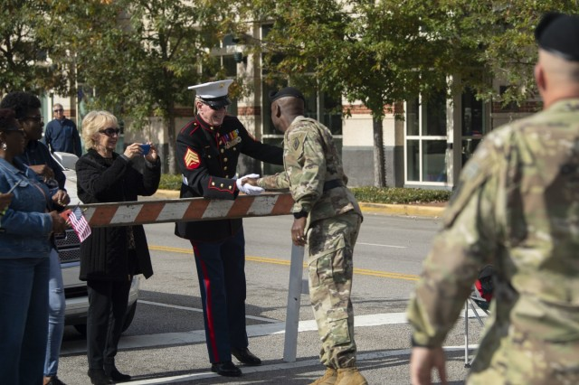 """U.S. Army Training Center and Fort Jackson Commander Brig. Gen. Milford """"Beags"""" Beagle Jr., greets a Marine along the Columbia, S.C., Veterans Day Parade route Nov. 11. Beagle greeted many veterans along the route and said 'thank you for your service.'"""