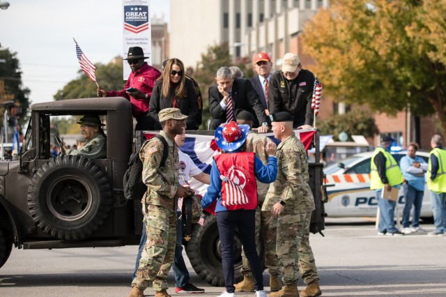 """U.S. Army Training Center and Fort Jackson Commander Brig. Gen. Milford """"Beags"""" Beagle Jr., and Post Command Sgt. Maj. Jerimiah Gan meet Columbia, S.C., city officials before the start of the Veteran's Day Parade Nov. 11. (Photo by Saskia Gabriel, Fort Jackson)"""