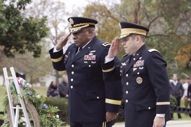 Lt. Gen. Charles Hooper, left, director of the Defense Security Cooperation Agency, and Col. Michael Greenberg, Garrison commander, salute during the Veterans Day Ceremony on Long Parade Field, Nov. 7.