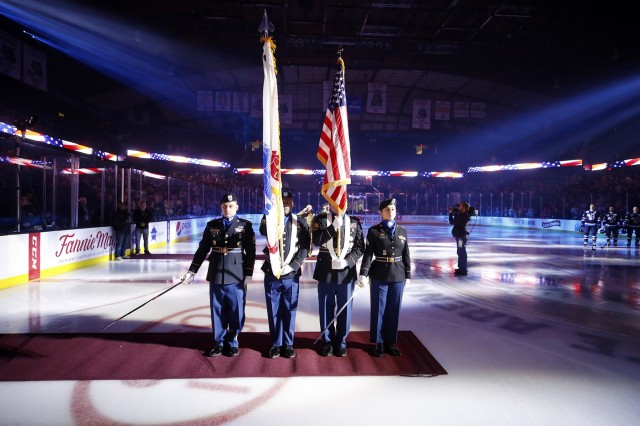 The 85th U.S. Army Reserve Support Command Color Guard team presents the Nation's Colors before the start of a Chicago Wolves hockey game at the Allstate Arena in Rosemont, Illinois, November 9, 2019. The Wolves played the Manitoba Moose during a military appreciation weekend event there. (Photo courtesy of the Chicago Wolves Hockey team)