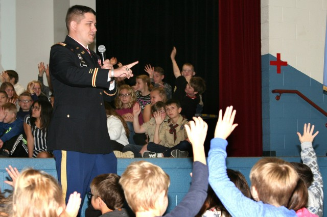 U.S. Army Capt. Shaun D. Swayne speaks to Cleveland, Okla., Intermediate School youth, as part of the school's annual Veterans Day ceremony. Swayne commissioned into the U.S. Army from the University of Memphis on Dec. 19, 2009, with a Bachelor's Degree in Civil Engineering.