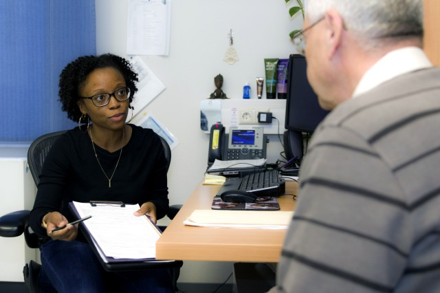 Jessica Sutherland, a nurse case manager at Landstuhl Regional Medical Center, reviews a form with a patient.