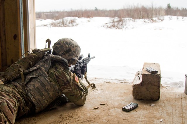 Staff Sgt. Justin Daniels, a food service specialist with Company H, 4th Battalion, 31st Infantry Regiment, fires the M4 carbine during a recent range at Fort Drum, N.Y.