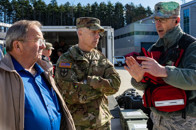 Brig. Gen. Donald Lagace, commander of the Maine Army National Guard, and Representative Sherman Hutchins of Penobscot County, receive a briefing from Lt. Col. John Gorham on the status of training during the New England CERFP's collective training exercise, Nov. 5-7, in Brunswick, Maine.