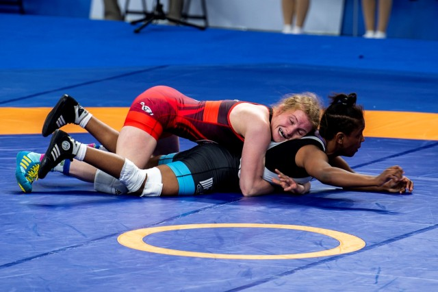 Staff Sgt. Whitney Conder wrestles against Nada Ashour of Egypt in the 50kg weight class. She went on to win the silver medal for women's freestyle 50kg.