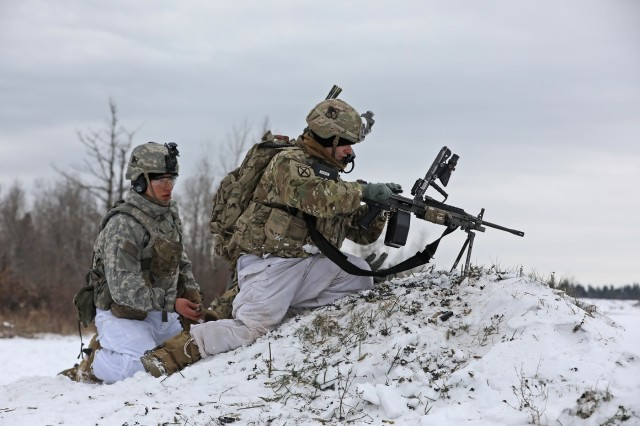 A Soldier from 2nd Battalion, 87th Infantry Regiment, 2nd Brigade Combat Team, 10th Mountain Division, clears a malfunction on an M249 squad automatic weapon during a platoon live fire training exercise, November 14, at Fort Drum, New York. During the scenario, Catamount Soldiers engaged targets simulating enemy forces with direct fire, while Mountain Sappers with the 41st Engineer Battalion breached a wire obstacle between the platoon and its objective. Soldiers across the Commando brigade have spent months progressing from individual tasks through Expert Infantryman Badge testing, to collective mission essential tasks during team, squad and platoon level training. Company and battalion live fires will follow in the coming months, and ultimately build toward brigade level certification at the Joint Readiness Training Center. (U.S. Army photo by Staff Sgt. Paige Behringer)