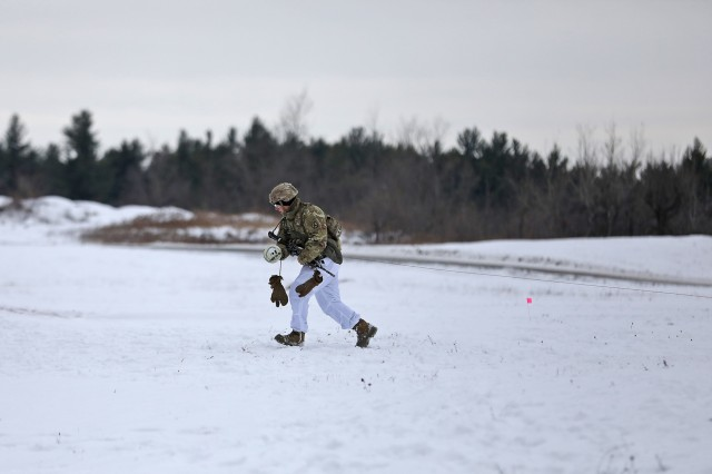 A Soldier assigned to the 41st Engineer Battalion, 2nd Brigade Combat Team, 10th Mountain Division, runs a line of fuse from a brazier charge while clearing a wire obstacle during a platoon live fire training exercise, November 14, at Fort Drum, New York. During the scenario, Soldiers assigned to 2nd Battalion, 87th Infantry Regiment, engaged targets simulating enemy forces with direct fire, while Mountain Sappers breached a wire obstacle between the infantry platoon and its objective. Soldiers across the Commando brigade have spent months progressing from individual tasks through Expert Infantryman Badge testing, to collective mission essential tasks during team, squad and platoon level training. Company and battalion live fires will follow in the coming months, and ultimately build toward brigade level certification at the Joint Readiness Training Center. (U.S. Army photo by Staff Sgt. Paige Behringer)