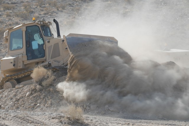"A 200kW dozer assigned to 3rd Cavalry regiment, ""Brave Rifles"" Fort Hood, TX, builds a tank trench during Decisive Action Rotation 20-02 at the National Training Center in Fort Irwin, Calif., Oct. 27, 2019. Decisive Action Rotations at the National Training Center ensure Army Brigade Combat Teams remain versatile, responsive, and consistently available for current and future contingencies. (U.S. Army photo by Spc. Jessica Rutledge, Operations Group, National Training Center)"