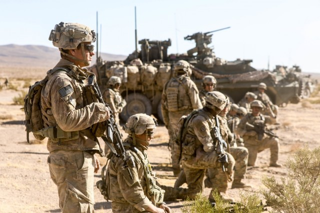 "U.S. Army Soldiers assigned to 3rd Cavalry regiment, ""Brave Rifles"" Fort Hood, TX, provides security during Decisive Action Rotation 20-02 at the National Training Center in Fort Irwin, Calif., Nov. 08, 2019. Decisive Action Rotations at the National Training Center ensure Army Brigade Combat Teams remain versatile, responsive, and consistently available for current and future contingencies. (U.S. Army photo by Spc. Kyler Chatman, Operations Group, National Training Center)"
