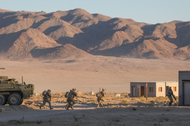 "U.S. Army Soldiers assigned to 3rd Cavalry Regiment ""Brave Rifles"", Fort Hood, TX, move their position forward during Decisive Action Rotation 20-02 at the National Training Center in Fort Irwin, California, Oct. 31, 2019. Decisive Action Rotations at the National Training Center ensure Army Brigade Combat Teams remain versatile, responsive, and consistently available for current and future contingencies. (U.S. Army photo by Pfc. Brooke Davis, Operations Group, National Training Center.)"