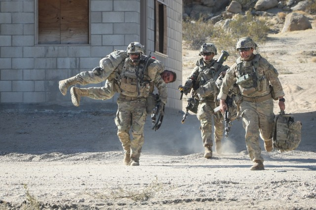 "U.S. Army Soldiers assigned to 3rd Cavalry Regiment ""Brave Rifles"", Fort Hood, TX, carry a simulated casualty to the evacuation point during Decisive Action Rotation 20-02 at the National Training Center in Fort Irwin, California, Oct. 31, 2019. Decisive Action Rotations at the National Training Center ensure Army Brigade Combat Teams remain versatile, responsive, and consistently available for current and future contingencies. (U.S. Army photo by Pfc. Brooke Davis, Operations Group, National Training Center.)"