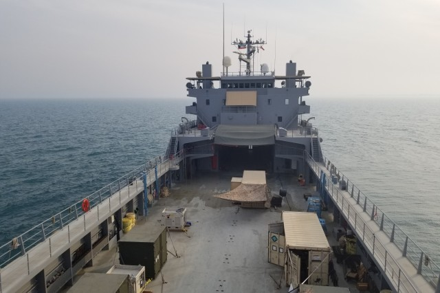 Raised view of the U.S. Army Logistic Support Vessel-5 cargo storage deck area. The vessel was docked off of Kuwait Naval Base, Kuwait, Oct. 23, 2019. The cargo storage deck is a multi-purpose area, and is often used as a physical training area by the mariner Soldiers who are part of the crew. (U.S. Army photo by Staff Sgt Robert Waters)