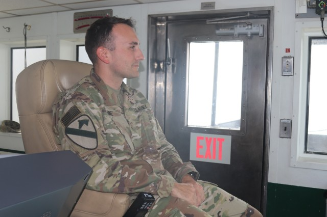 U.S. Army Warrant Officer Brandon Tune, 411th Transportation Detachment, a native of Wisconsin, scans the waters near Kuwait Naval Base from the bridge of U.S. Army Logistic Support Vehicle (LSV-5) Oct. 23, 2019. Tune was a combat Medic, and Army practical nurse before joining the Army Maritime Service. (U.S. Army photo by Staff Sgt. Robert Waters)