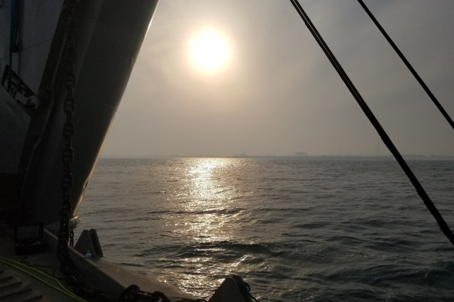 Sunset as viewed from the front ramp area of the U.S. Army Logistic Support Vessel-5 (LSV-5), off the waters of Kuwait Naval Base, Kuwait, Oct. 23, 2019. In addition to the three on board cranes, another unique feature is the large ramp at the front of the vessel that allows the LSV to move cargo/vehicles from a larger vessel, directly to the shore. (U.S. Army photo by Staff Sgt Robert Waters)
