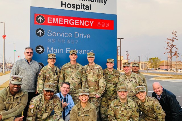 BDAACH Command team took the cover off the signage at the entrance of the hospital before the official first patient day on 15 November, 2019.