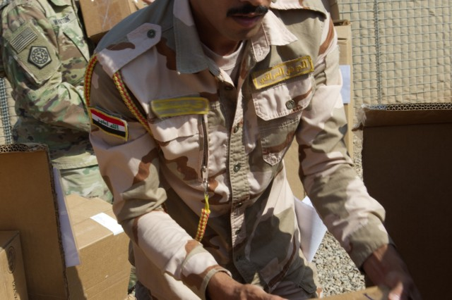 A soldier at the Iraq Army Transportation Brigade packs vehicle repair parts into a truck at a collection point to be transported by the Iraq Army Transportation Team to the Iraq's Joint Repair Parts Command near Camp Taji, Iraq, Oct. 23, 2019. Iraqi soldiers took charge of one of the largest divestments of vehicle repair parts at the Taji National Depot (U.S. Army photo by Capt. Karla M. Crayne)